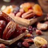 depositphotos_232037512-stock-photo-various-dried-fruits-nuts-old